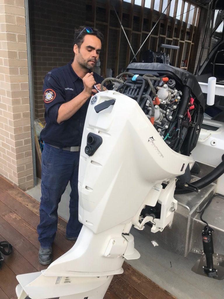 Mechanic fixing outboard motor